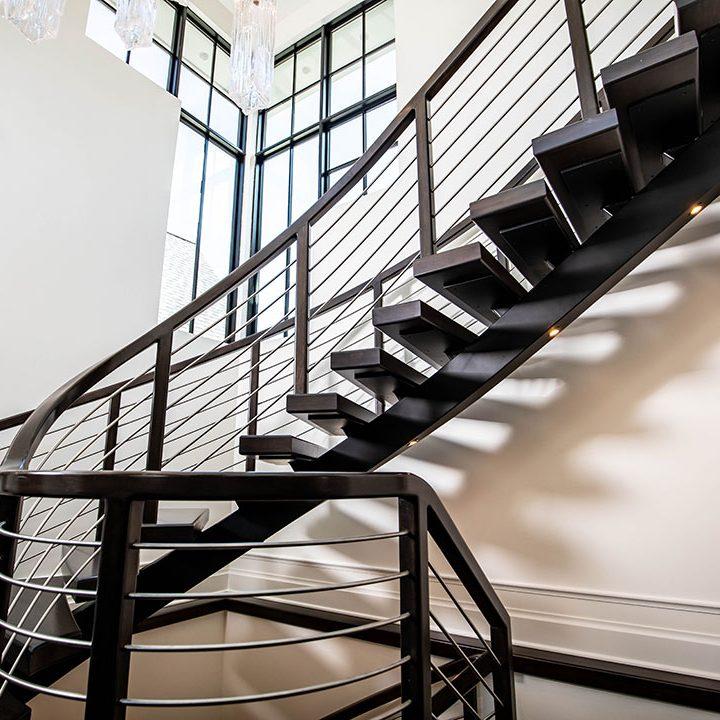 Curved Metal Mono-beam Stairway Project | Heartland Stairways